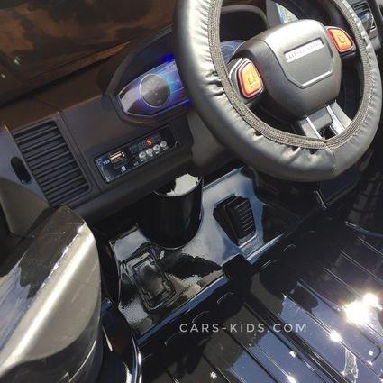 Электромобиль 4WD Range Rover XMX601 (Happer Superman) 2-х местный, черный (усиленный аккумулятор, резиновые колеса, кожа, пульт, музыка, глянцевая покраска)
